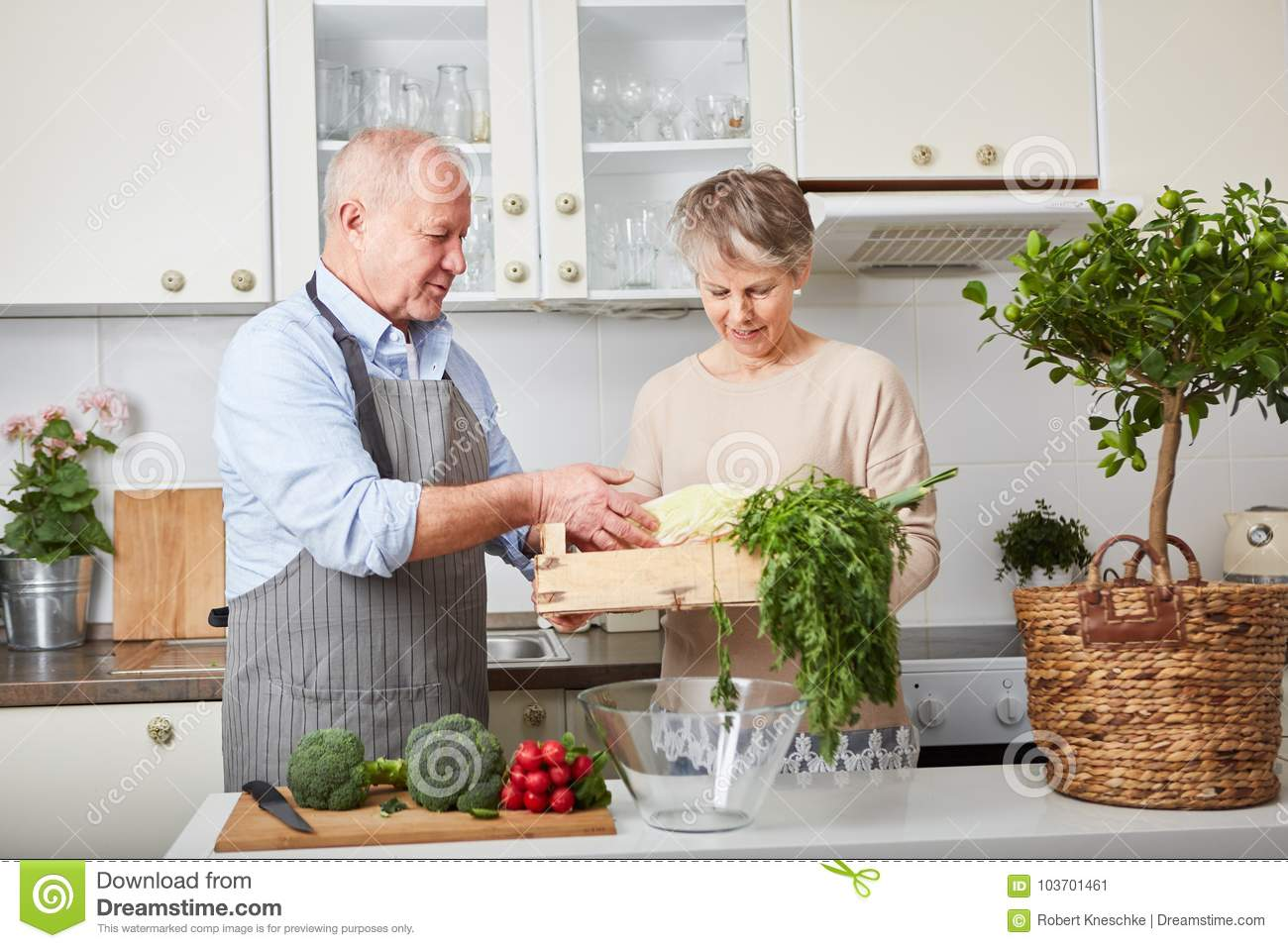 Seniors as couple cooking together