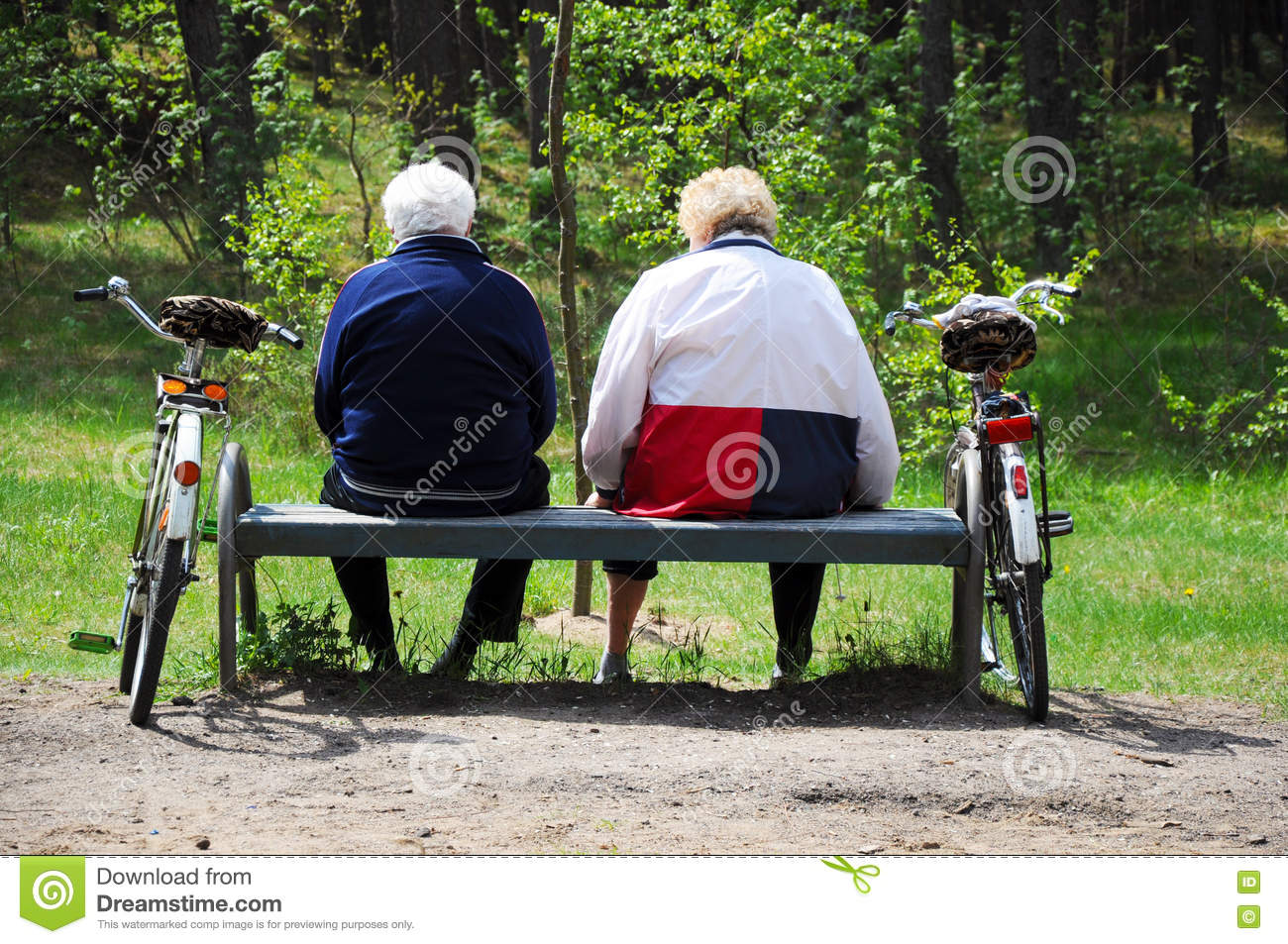 Seniors couple cyclists resting
