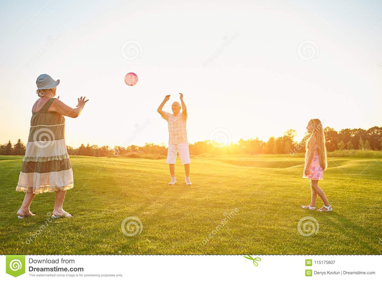 Seniors with granddaughter playing ball.