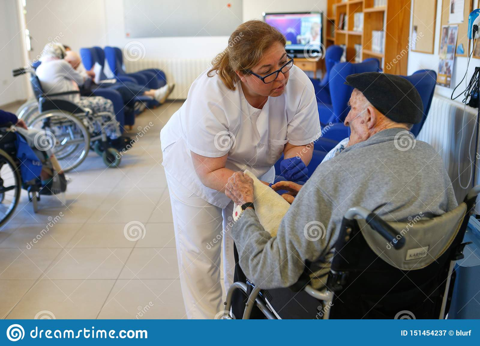 Seniors and nurse during their daylife on a nursing home in Mallorca