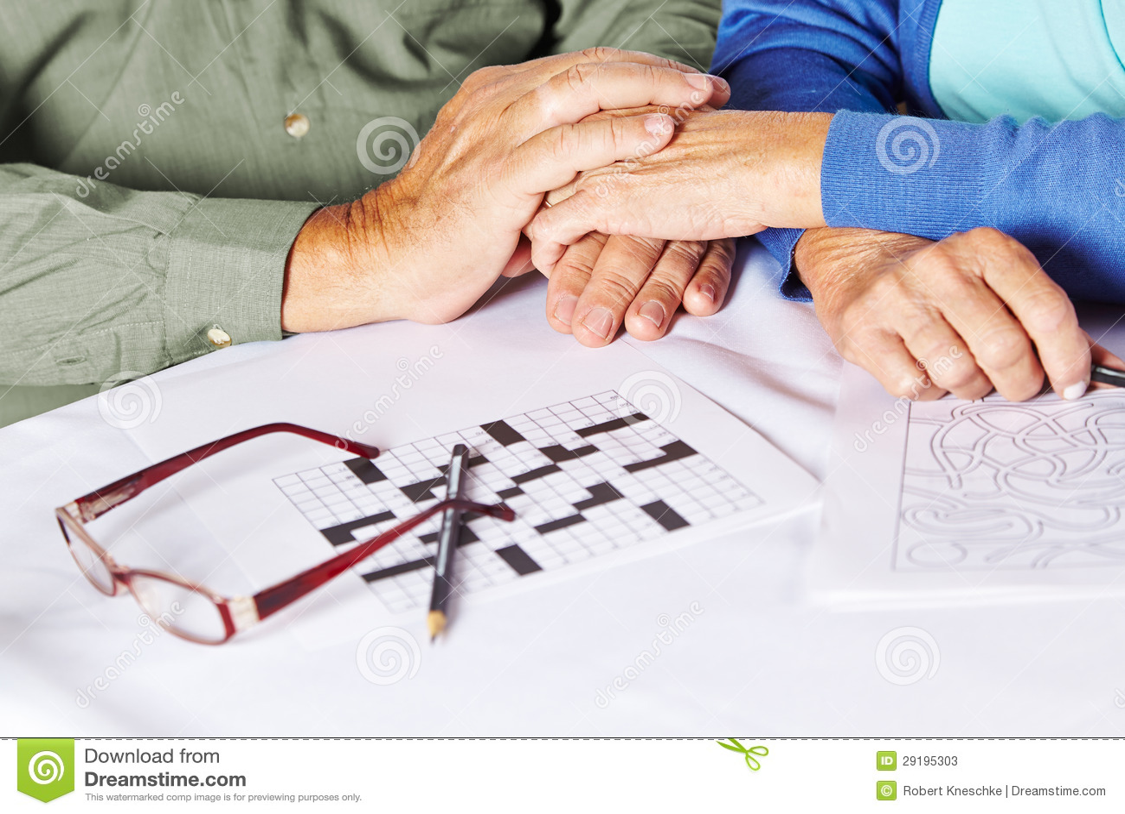 Seniors holding hands in nursing