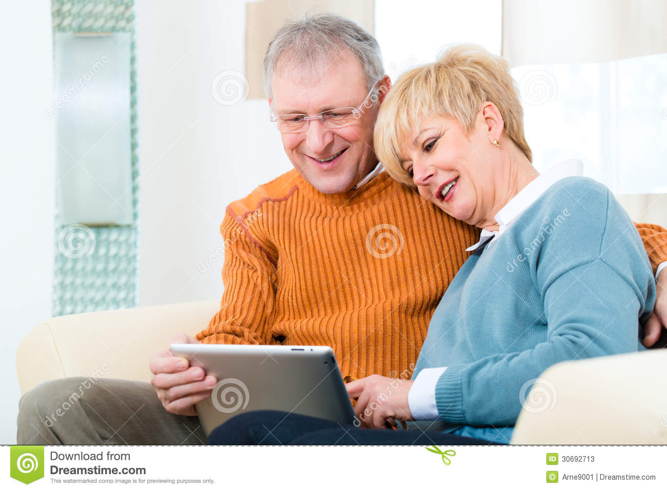 Seniors At Home With Tablet Computer Stock Photos Image