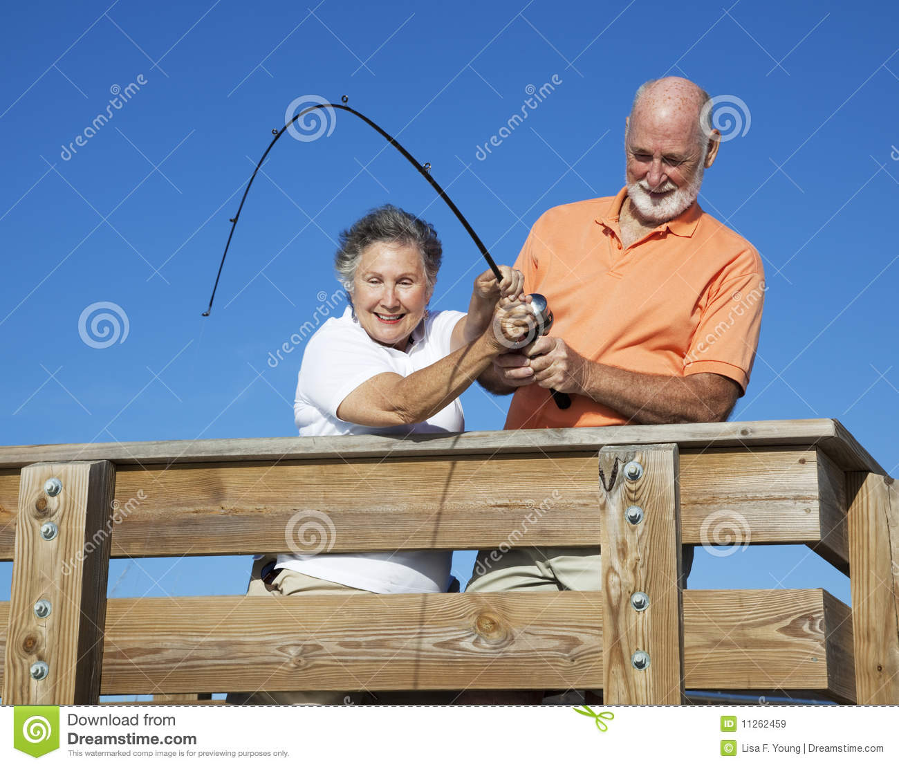 Seniors reeling in a big fish royalty free stock images for Florida fishing license for seniors