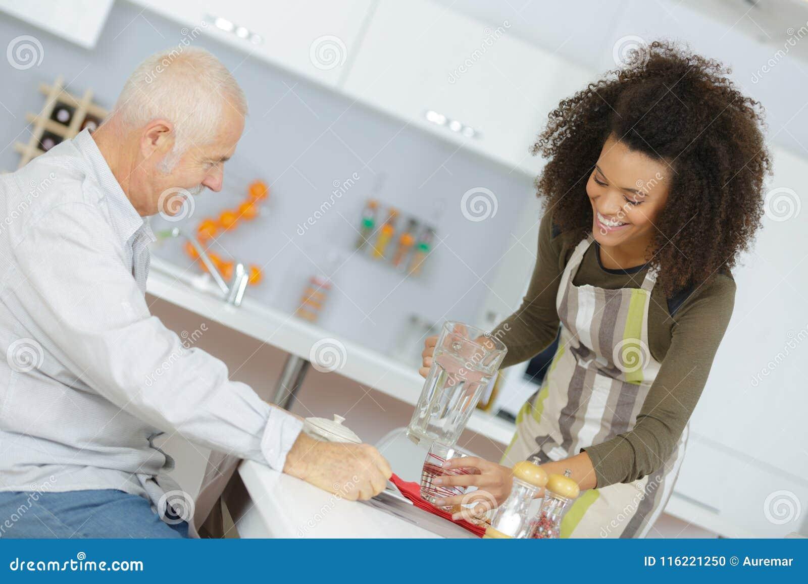 Senios having food in nursing home