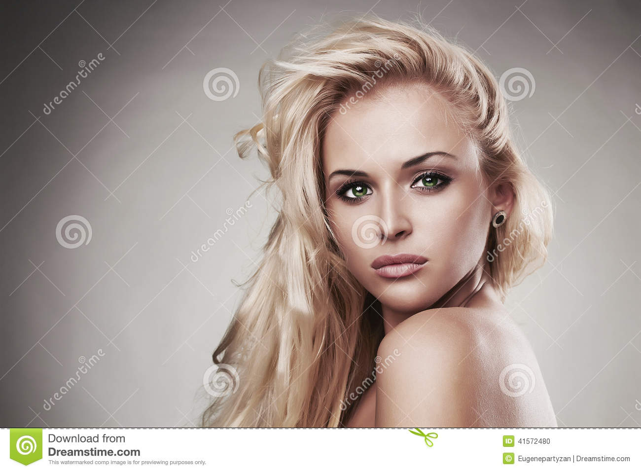 Sensitive Beautiful blond woman.hairstyle.salon care.sexy young girl. close-up portrait. green eyes