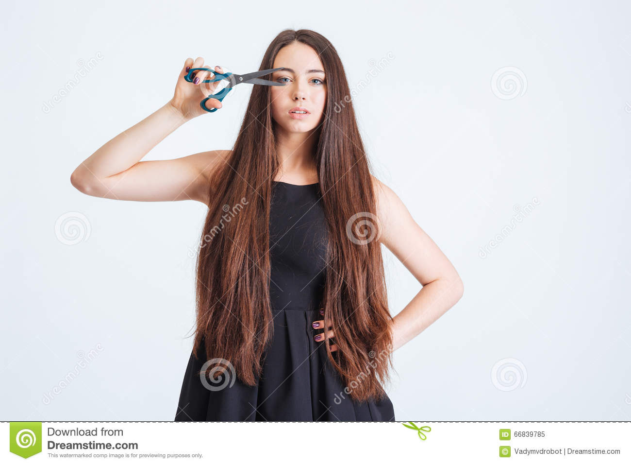 Portrait Of Beautiful Young Woman With Scissors Cutting