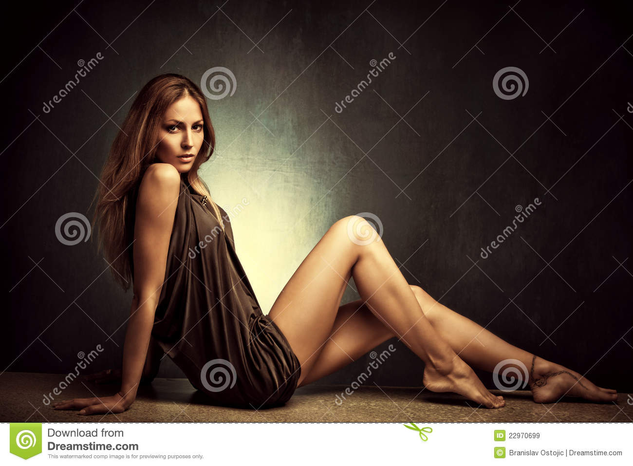 Young woman in elegant short dress sit barefoot, full body shot ...