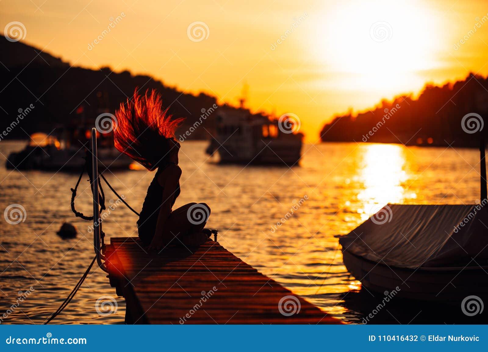 Sensual carefree summer woman enjoying vacation.Seaside stress less lifestyle.Fit traveler enjoying life.Full of energy.Energetic