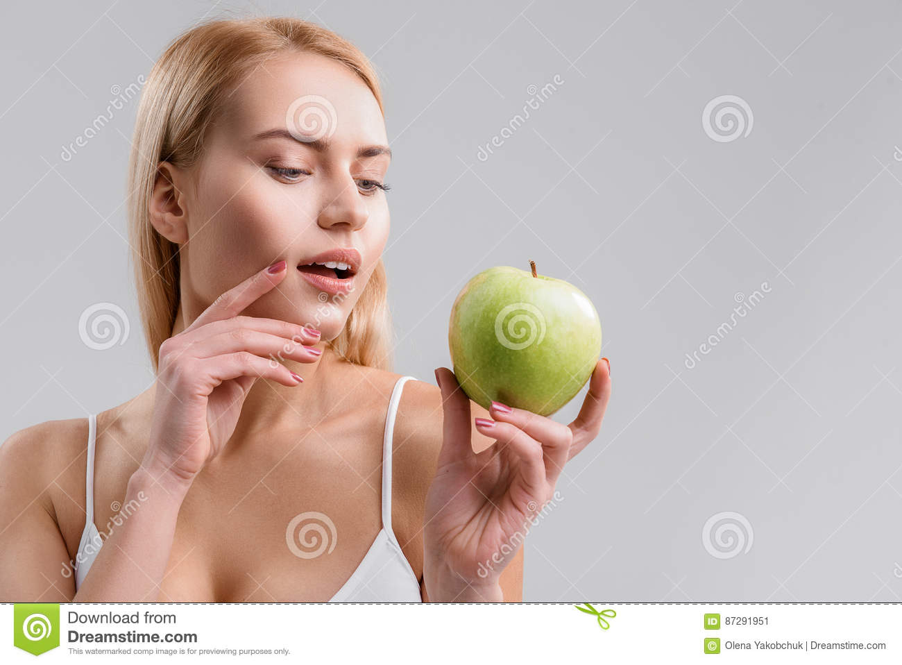 Sensual woman eating healthy food