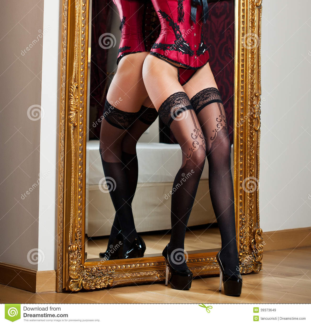 Sensual Woman With Long Legs And High Heels In Corset ...