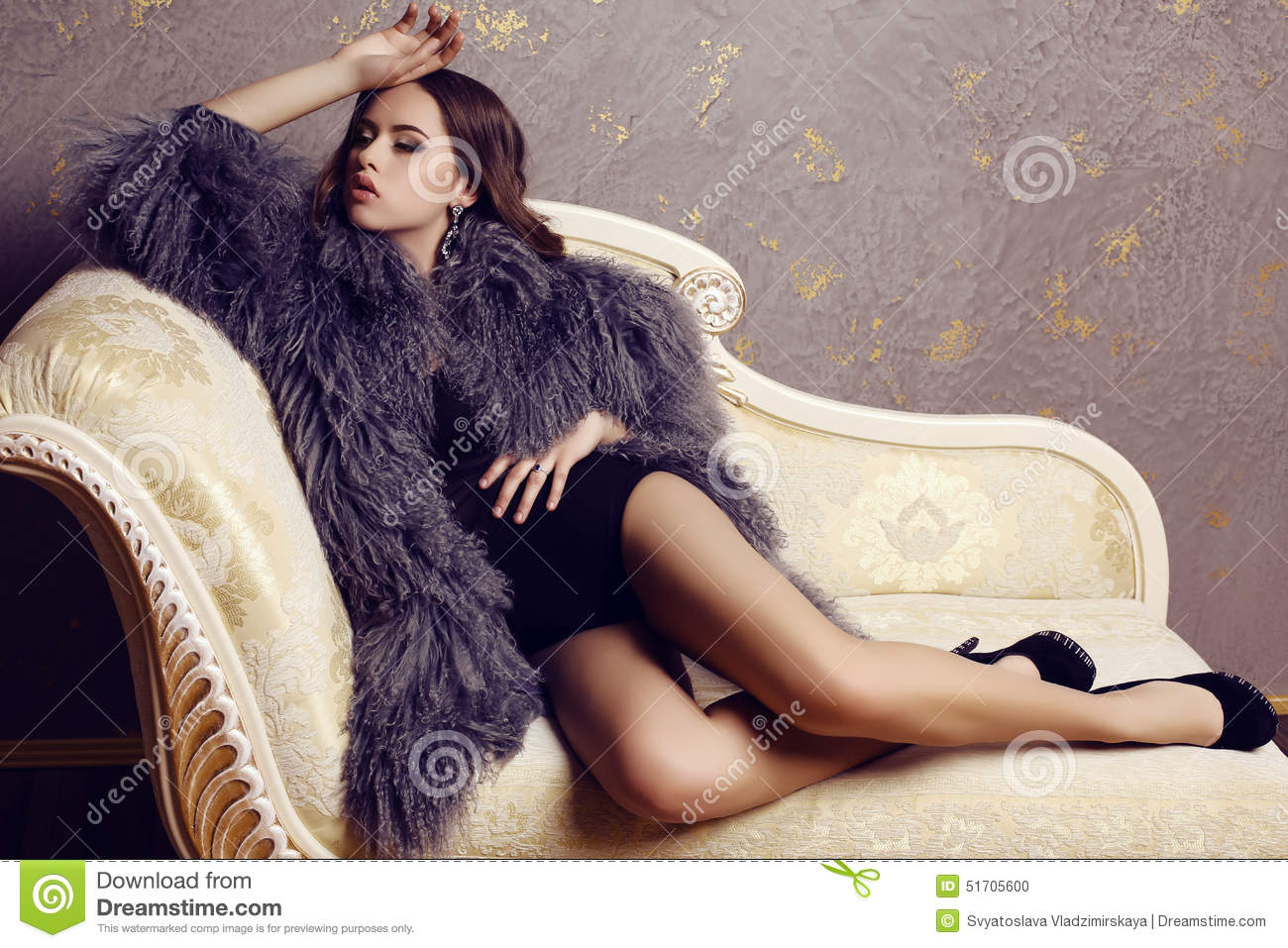 Sensual Woman With Luxurious Curly Hair Wearing Elegant