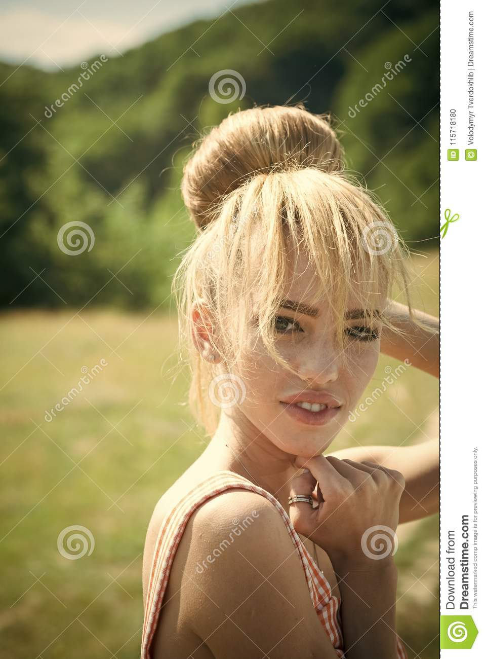 Sensual woman with makeup on cute face. Fashion cosmetics for skincare. Retro woman with stylish blond hair outdoor