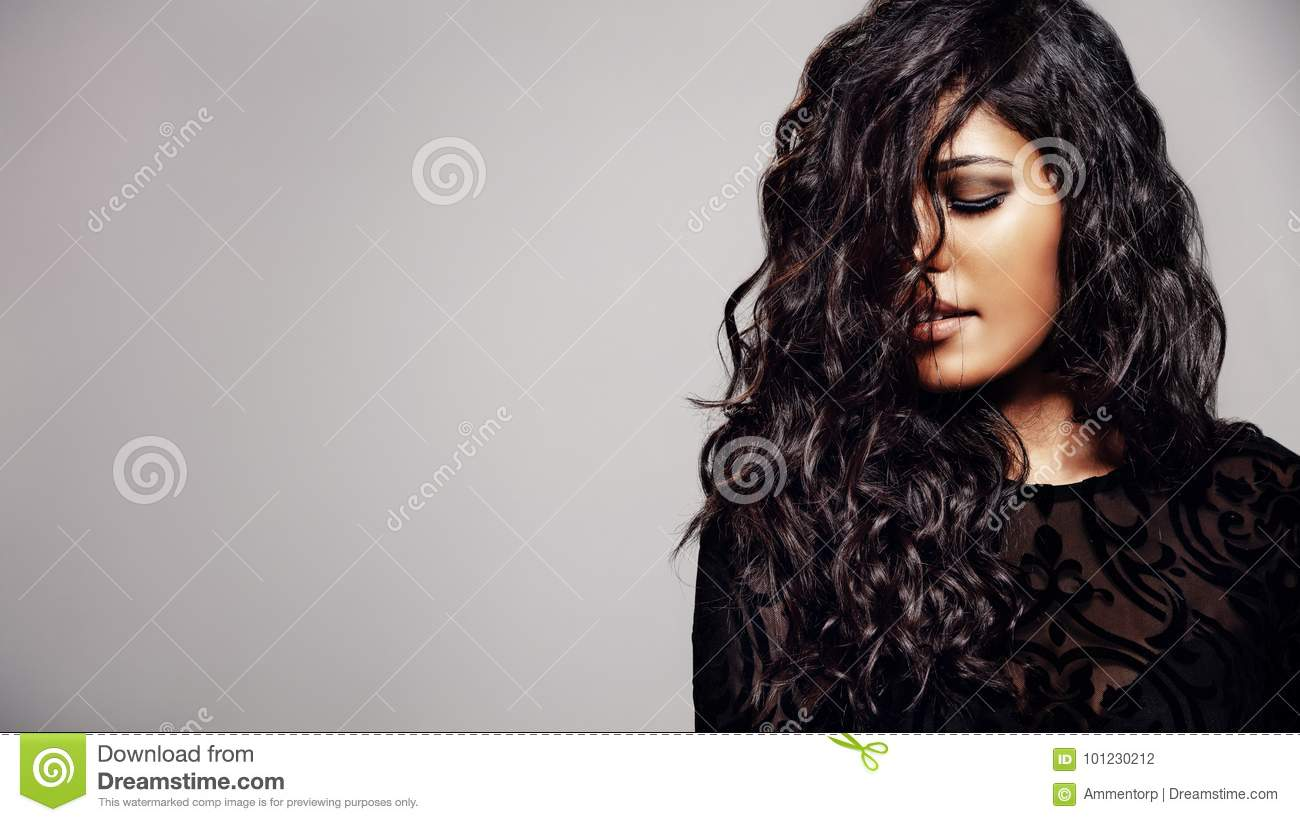 Sensual woman with shiny curly hair