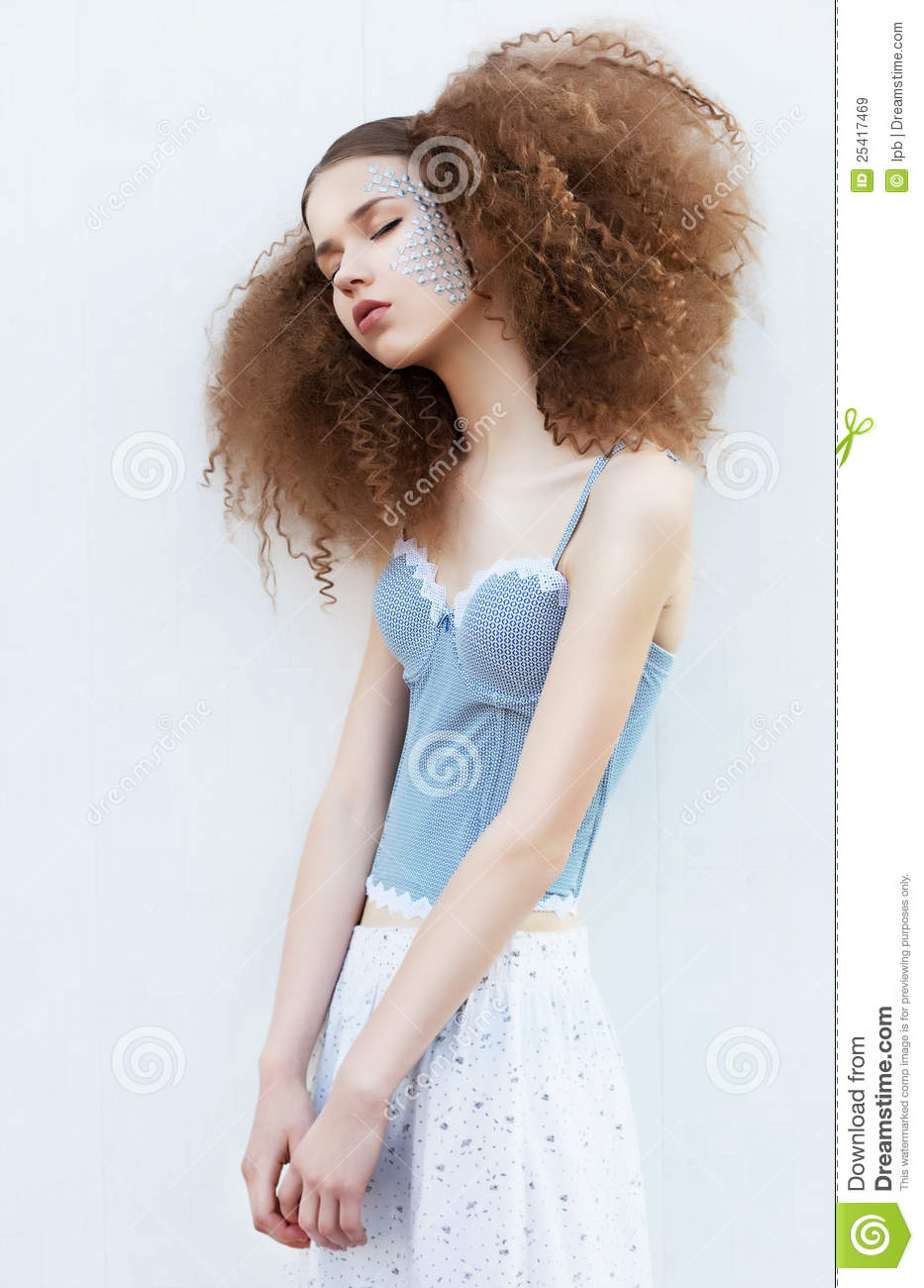Sensual young slimfemale with closed eyes standing