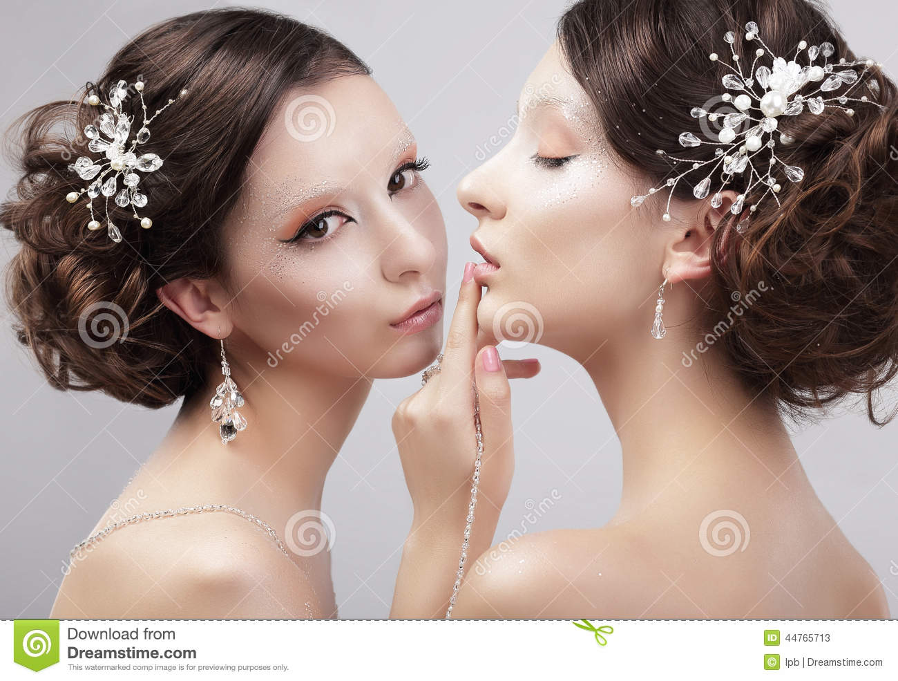 Sensuality. Two Women Fashion Models with Trendy Make-up