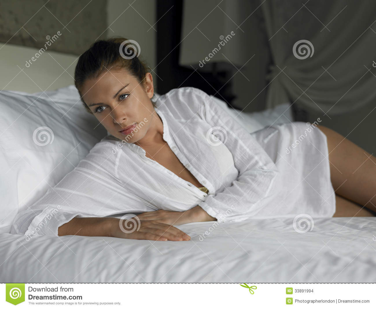 Sensuous Woman Lying In Bed
