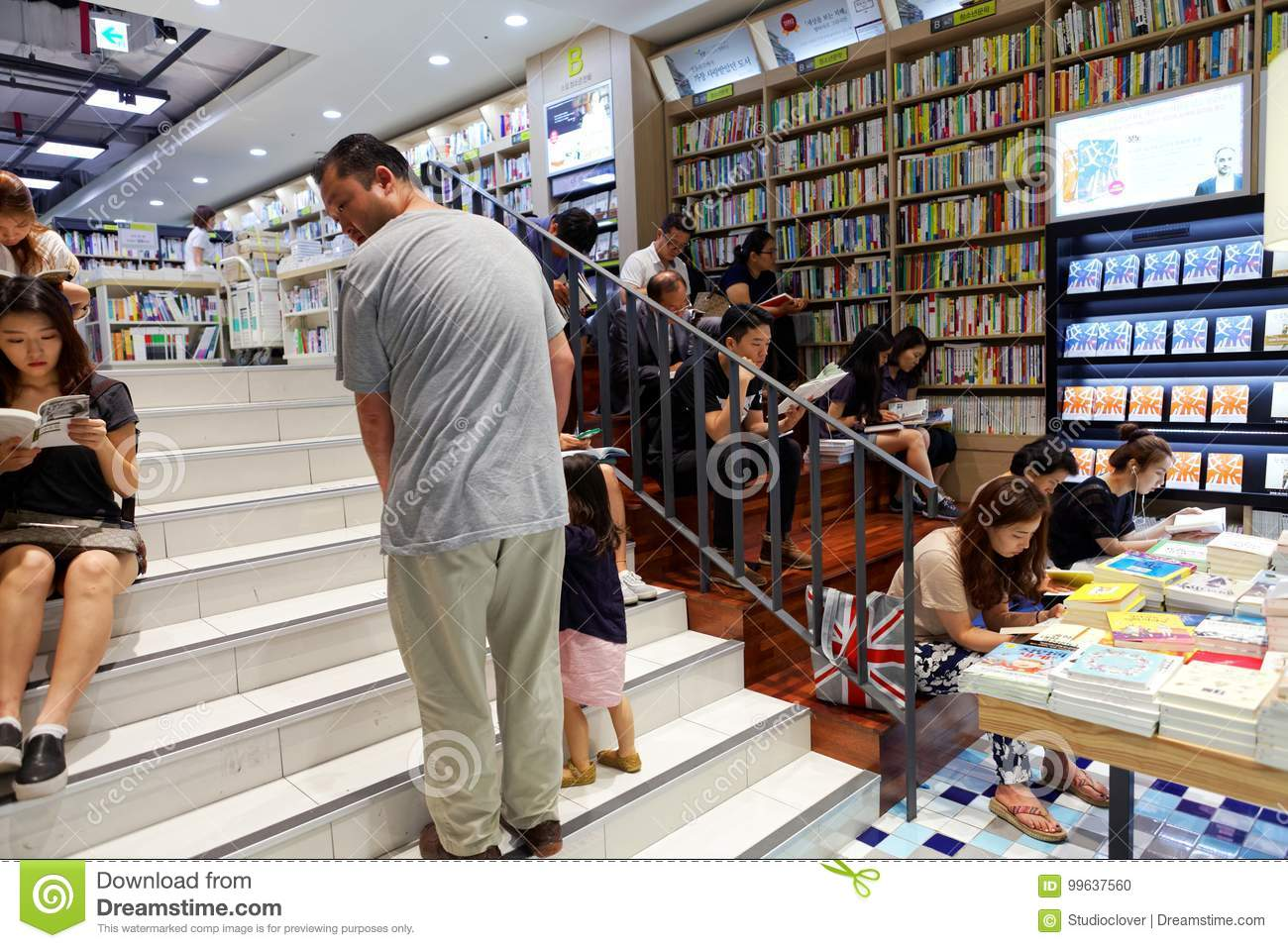 SEOUL, KOREA - AUGUST 13, 2015: People reading books in bookstore of COEX convention and exhibition center - Seoul, South Korea