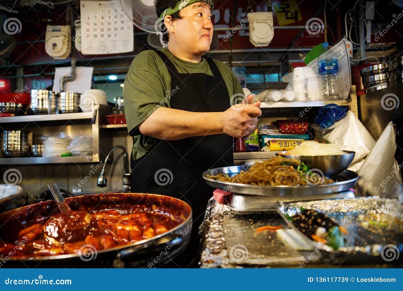 Cook at a street food stall in Gwanjang Market, Seoul, South Korea