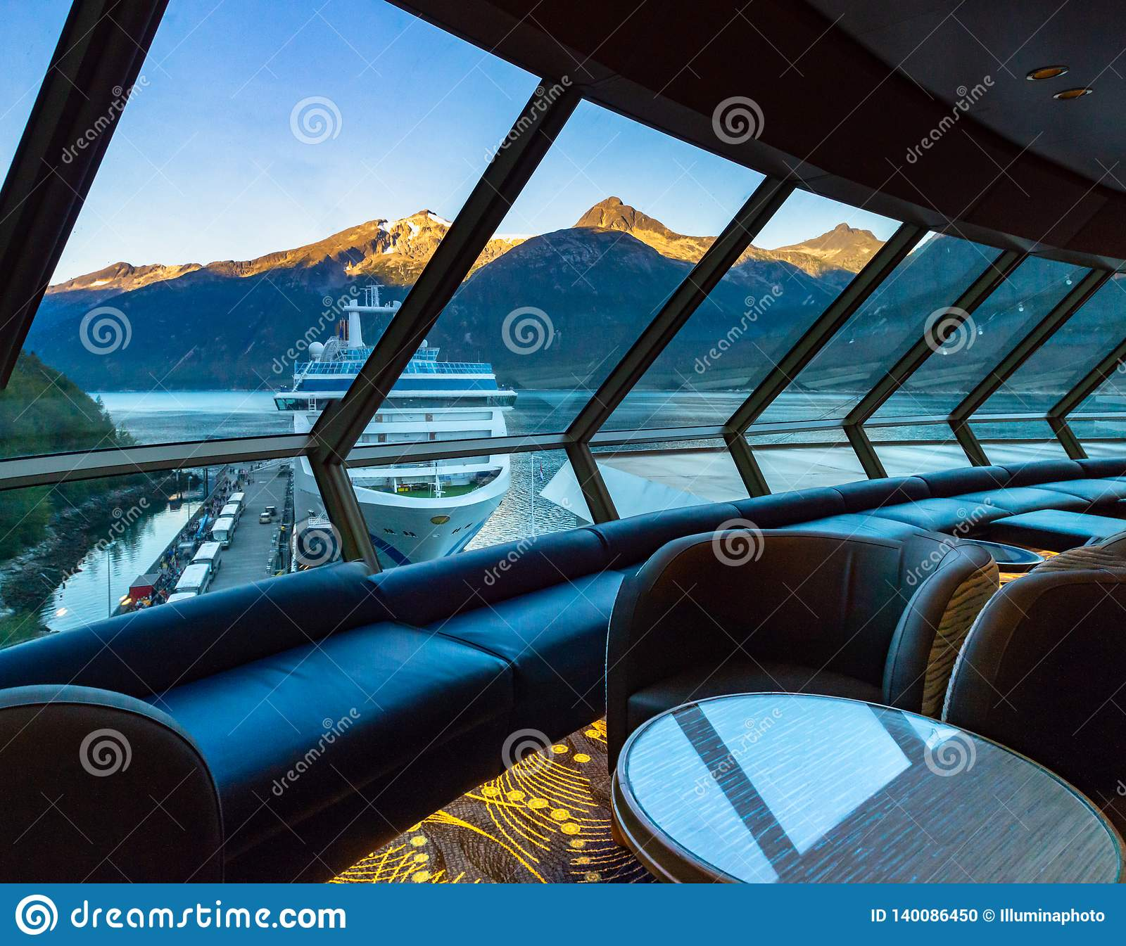 September 15, 2018 - Skagway, AK: Sunrise view of ship in port from inside The Crow`s Nest aboard The Volendam.