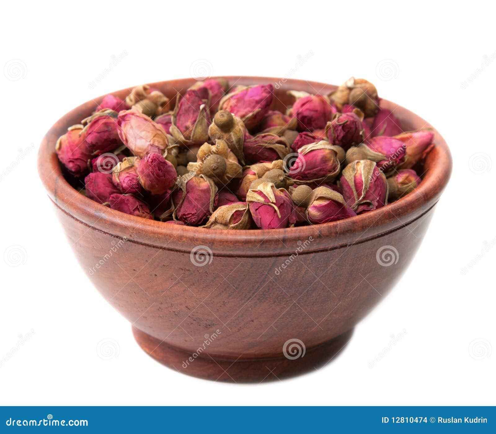 Seque cor-de-rosa no copo de madeira