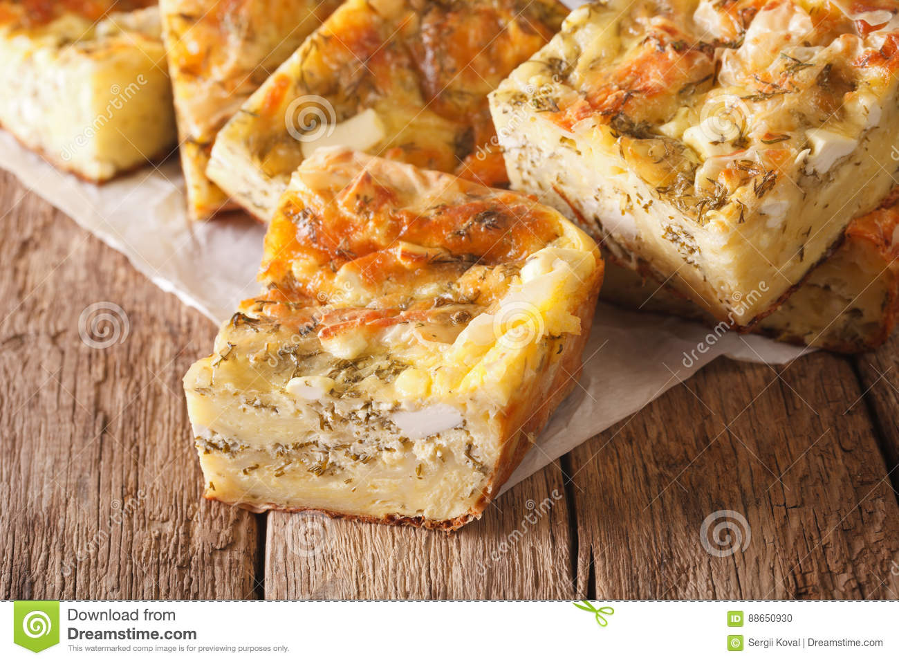 Serbian food: sliced pie Gibanica with cheese, eggs and greens c