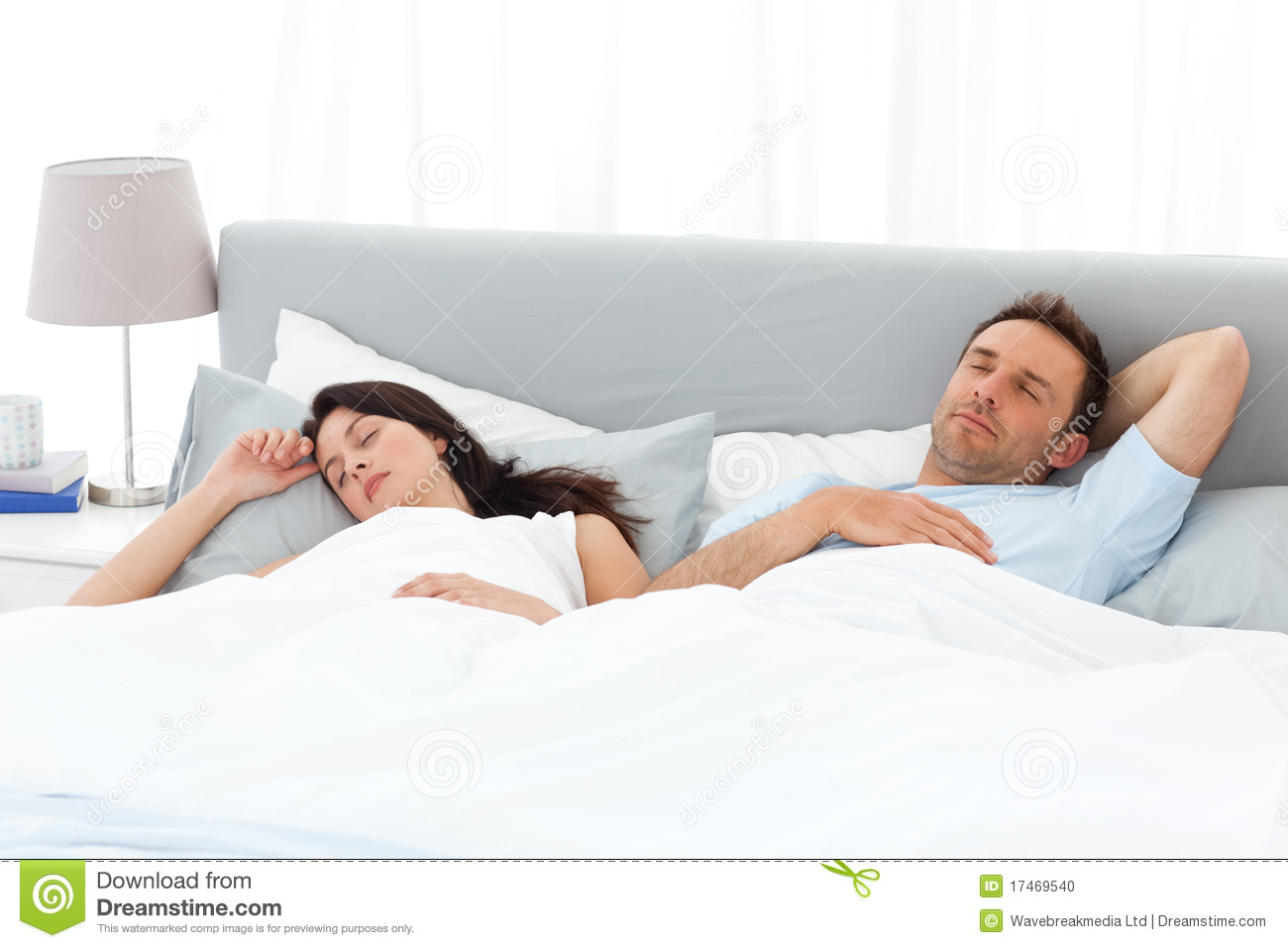 Serene Couple Sleeping On Their Bed In The Morning Stock