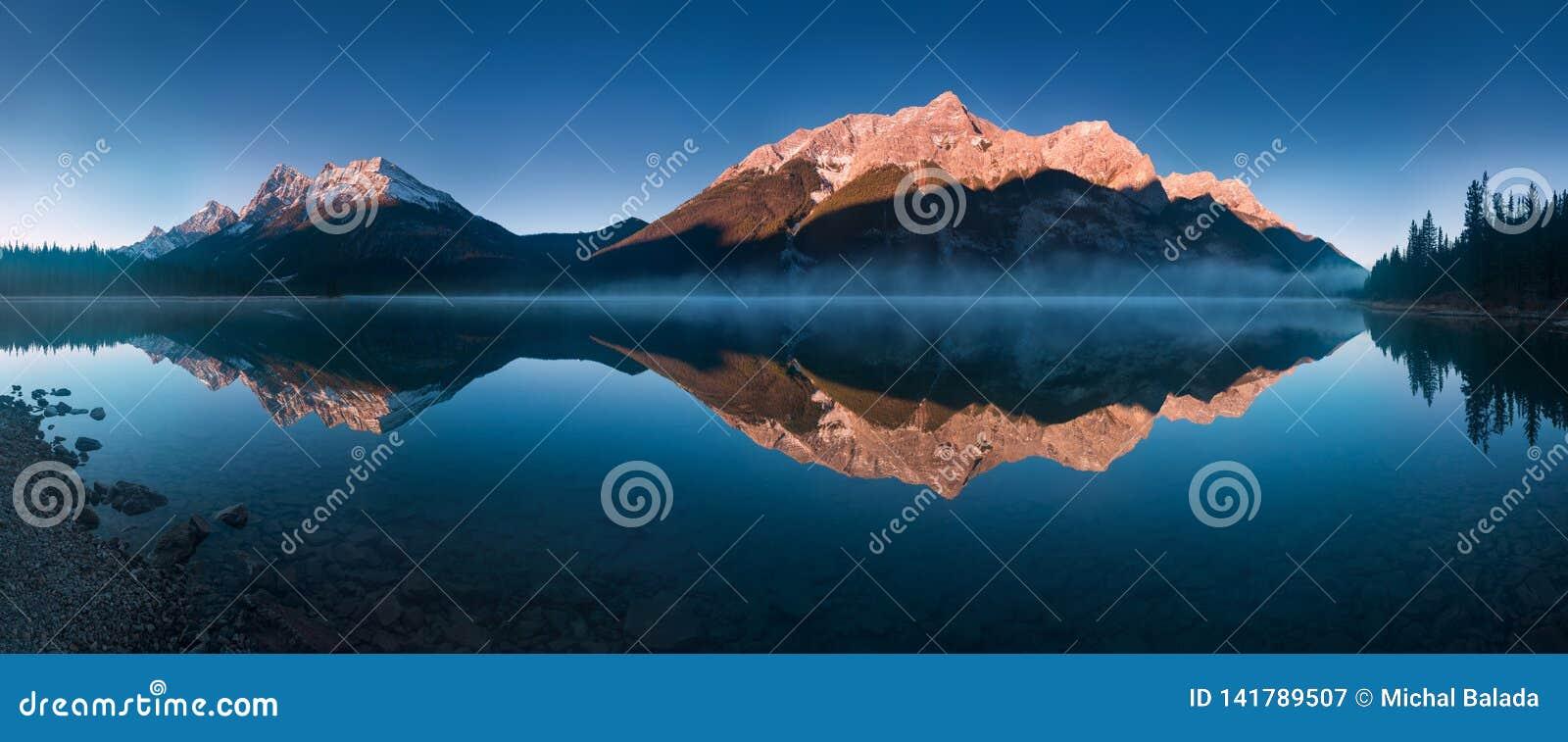 Serene sunrise at the Spray Lakes Reservoir is a reservoir in Alberta, Canada. The Spray Lakes