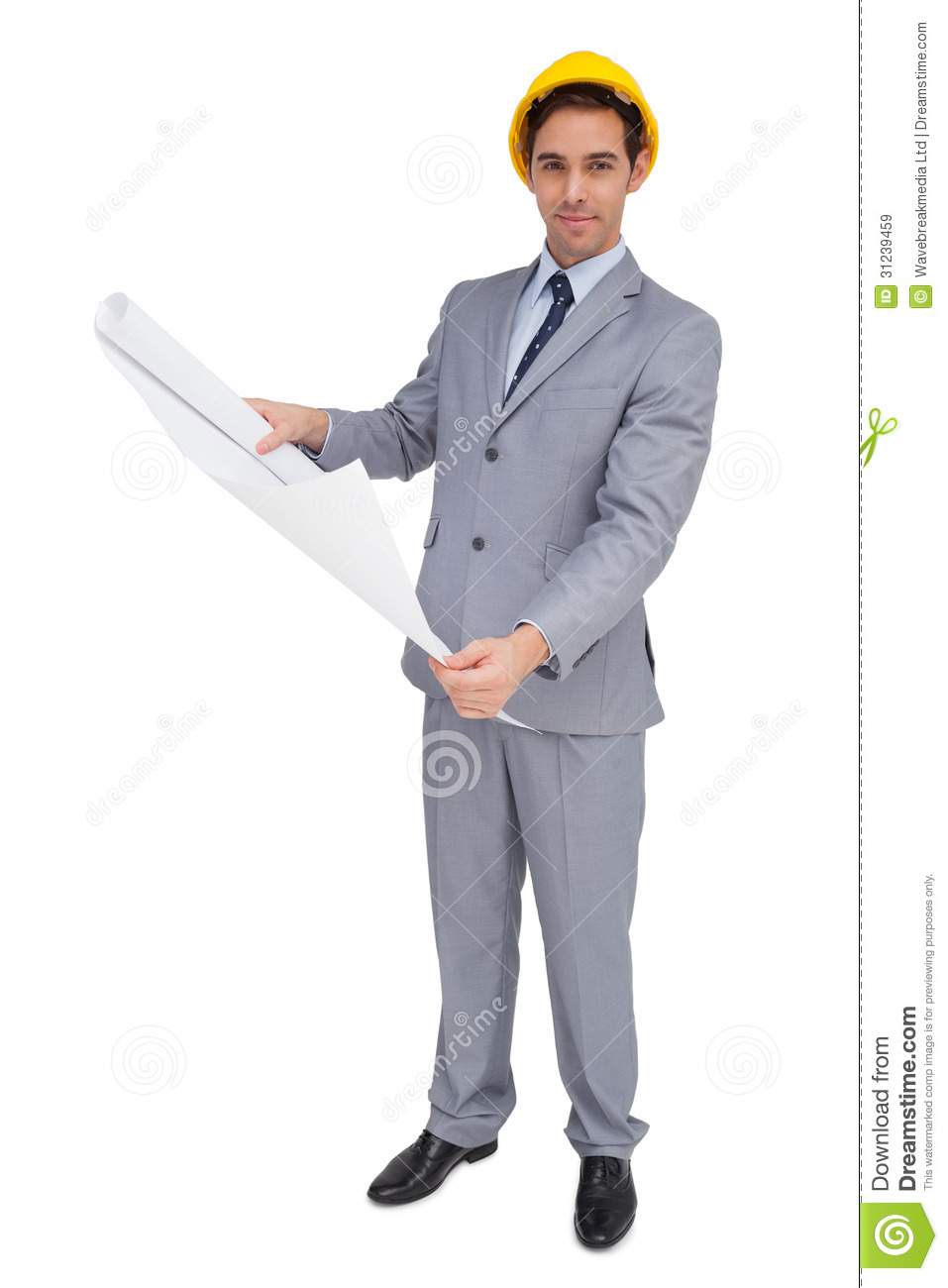 Serious Architect With Hard Hat Holding Plans Royalty Free
