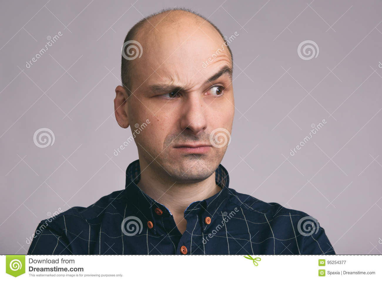 Serious Bald Man With Raised Eyebrow Stock Image Image Of Face