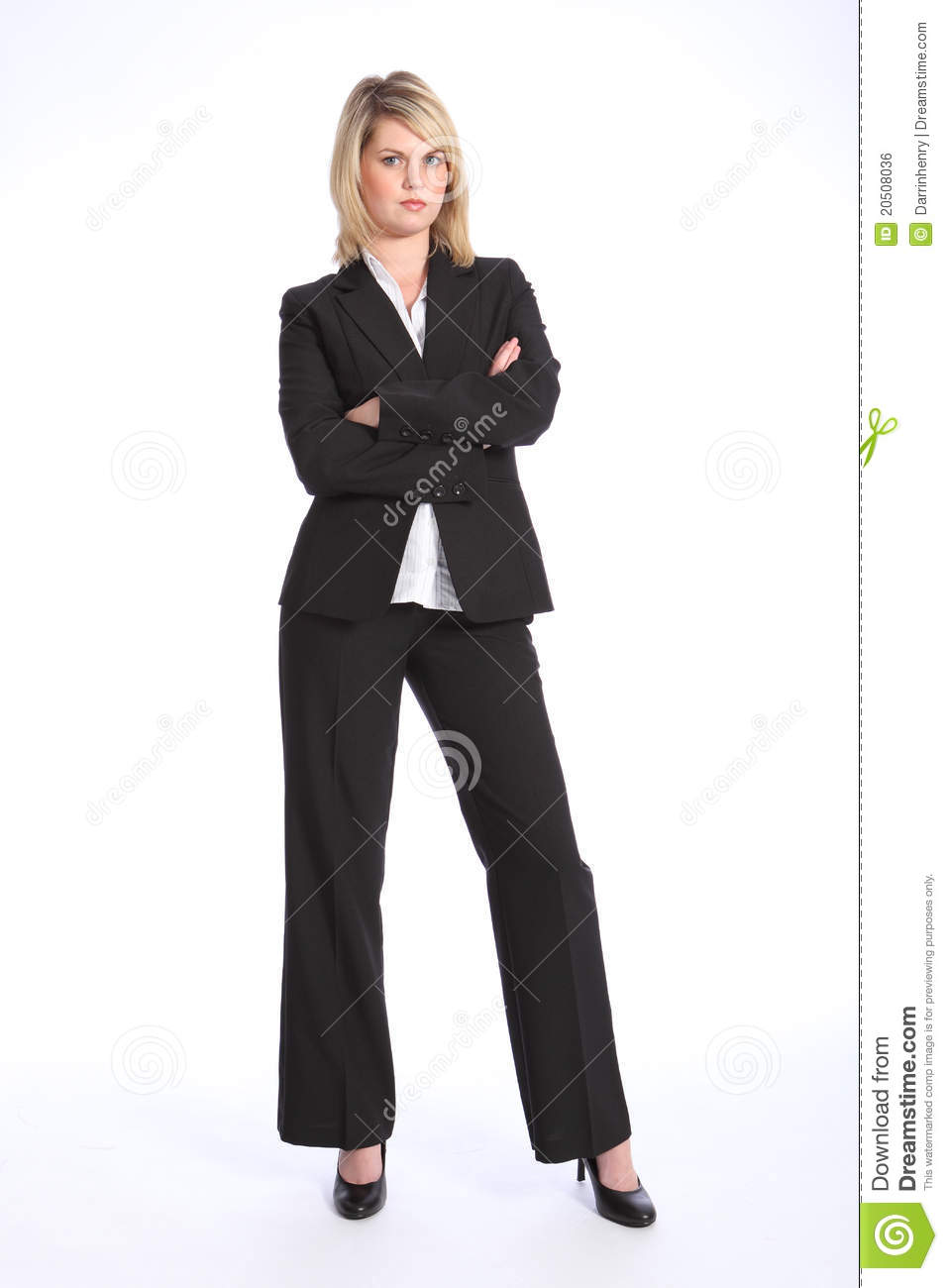Serious blonde woman in business suit arms folded