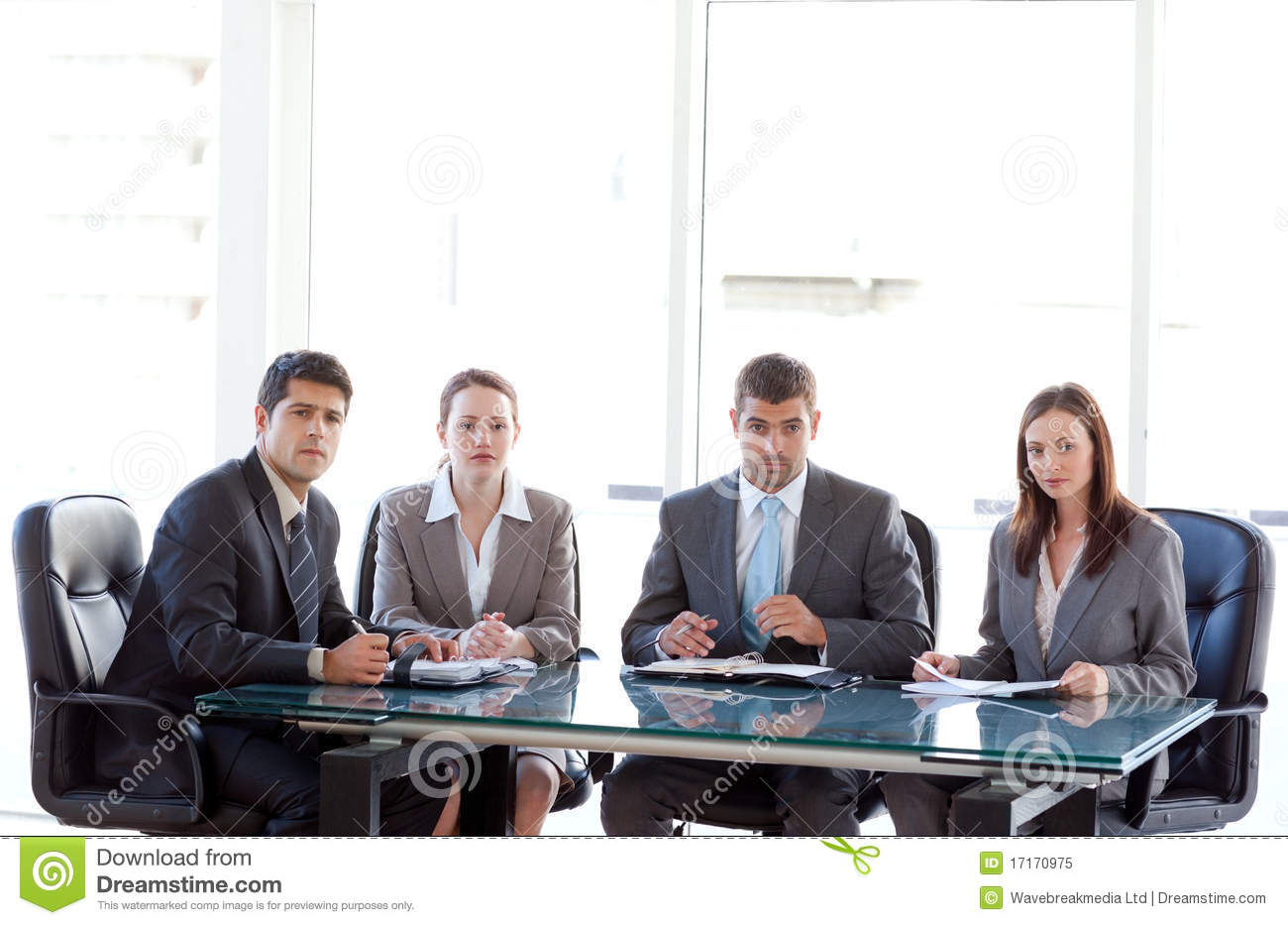 Serious business team sitting around a table