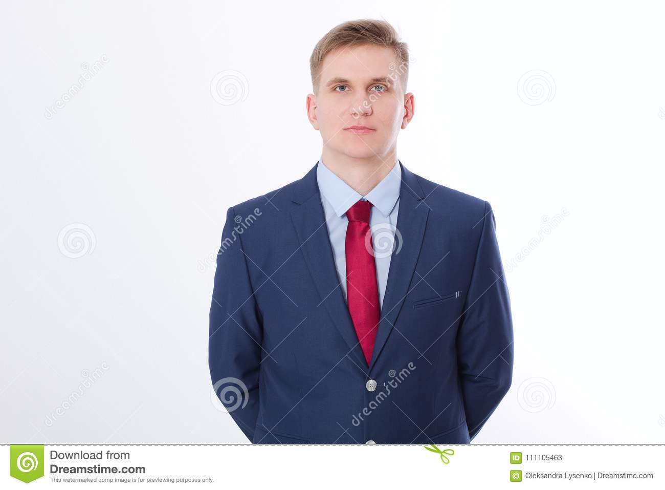 Serious businessman in blue suit and red tie isolated on white background. Business concept. Copy space and mock up.
