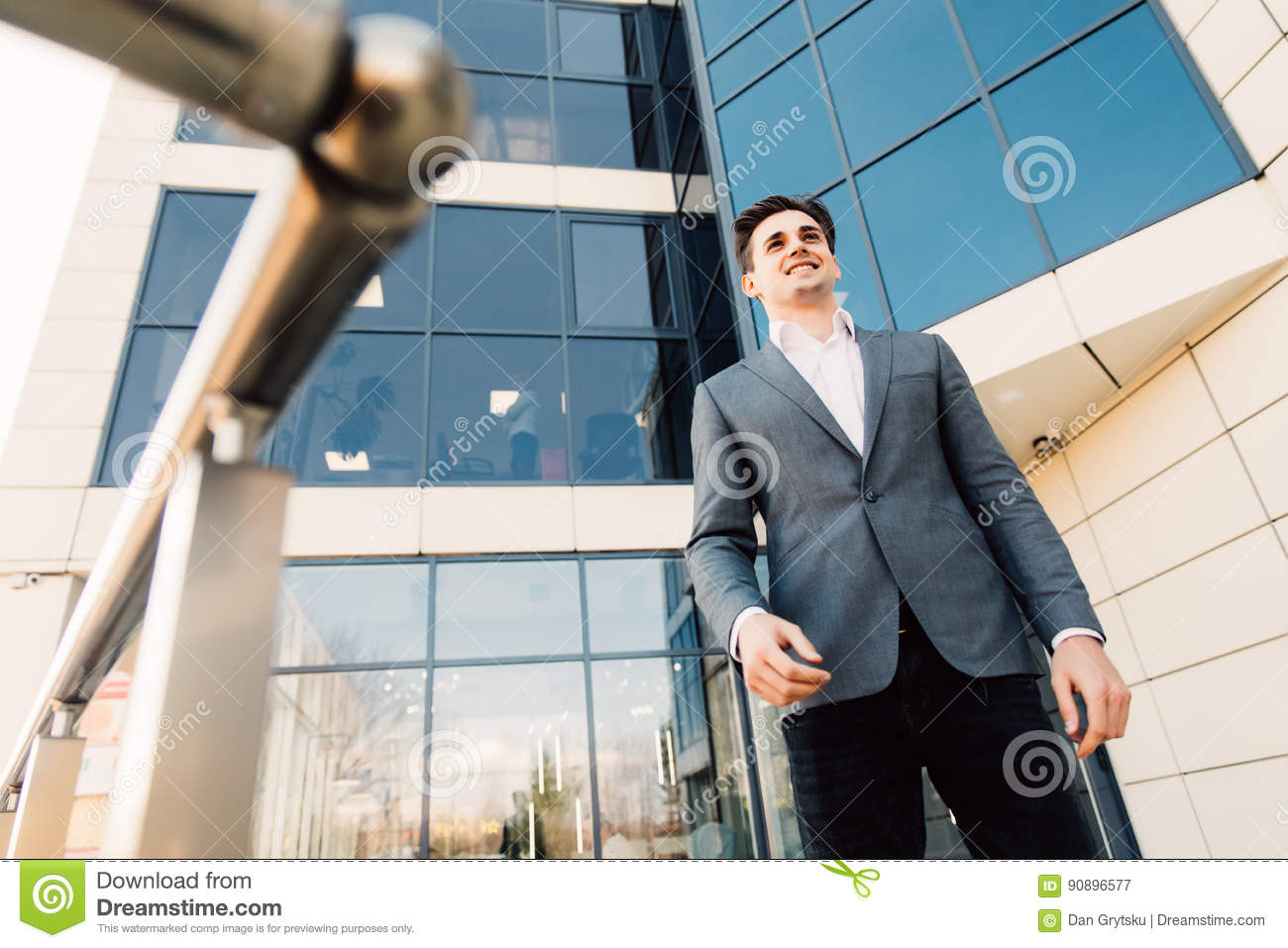 serious businessman in eye glasses looking on copy space while