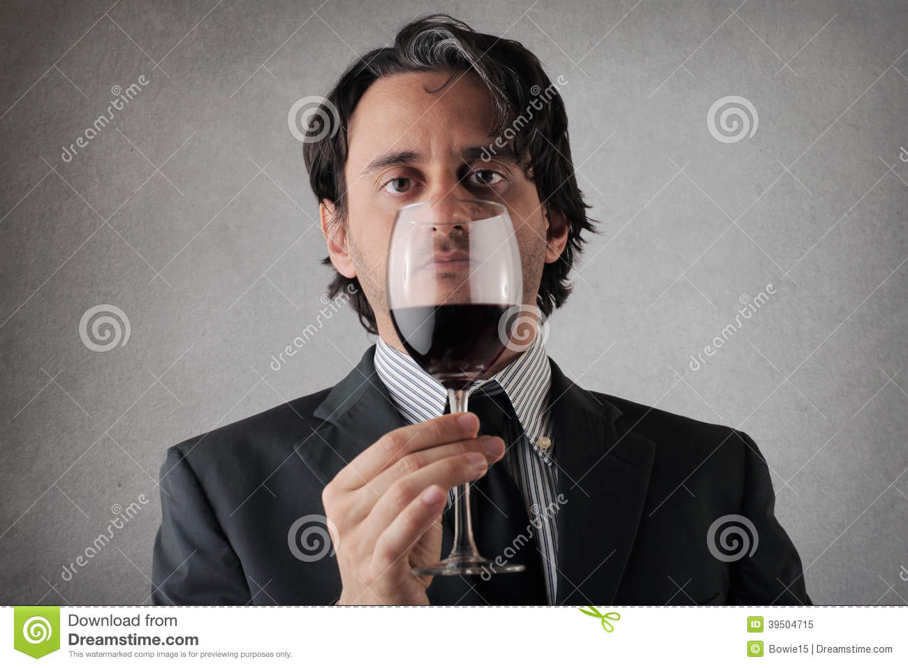 Serious businessman with a glass of wine