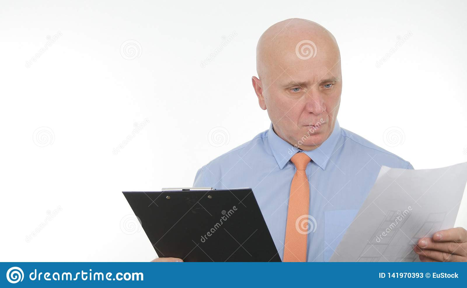 Serious Businessman in Office Room Read and Analyze Financial Documents