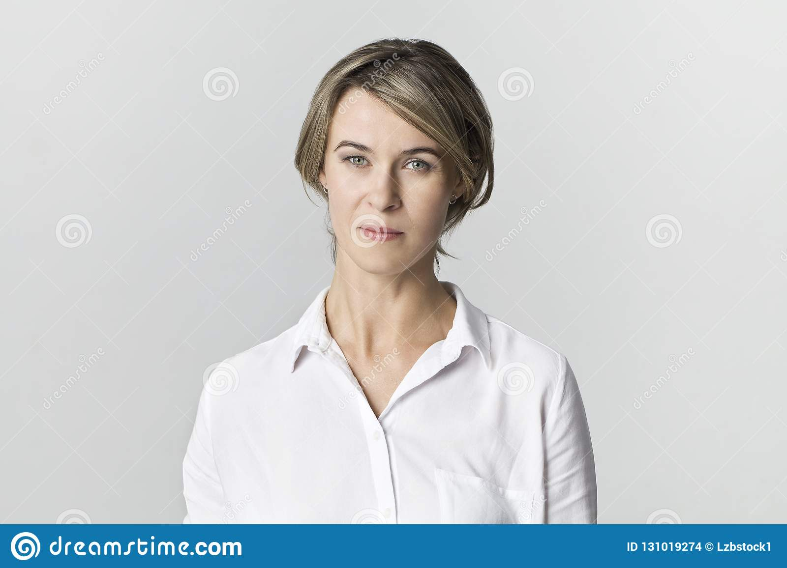 Serious businesswoman standing. Confidence woman in white shirt
