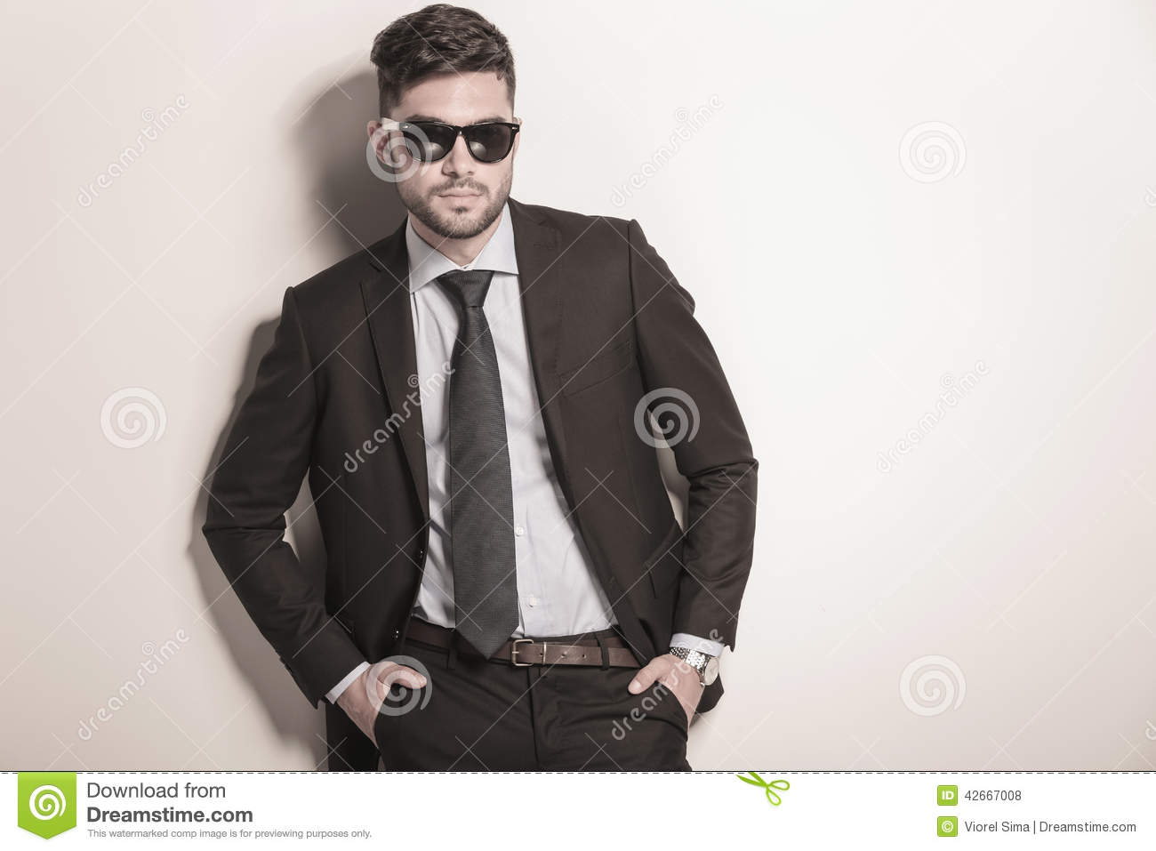 Serious and cool business man wearing sunglasses