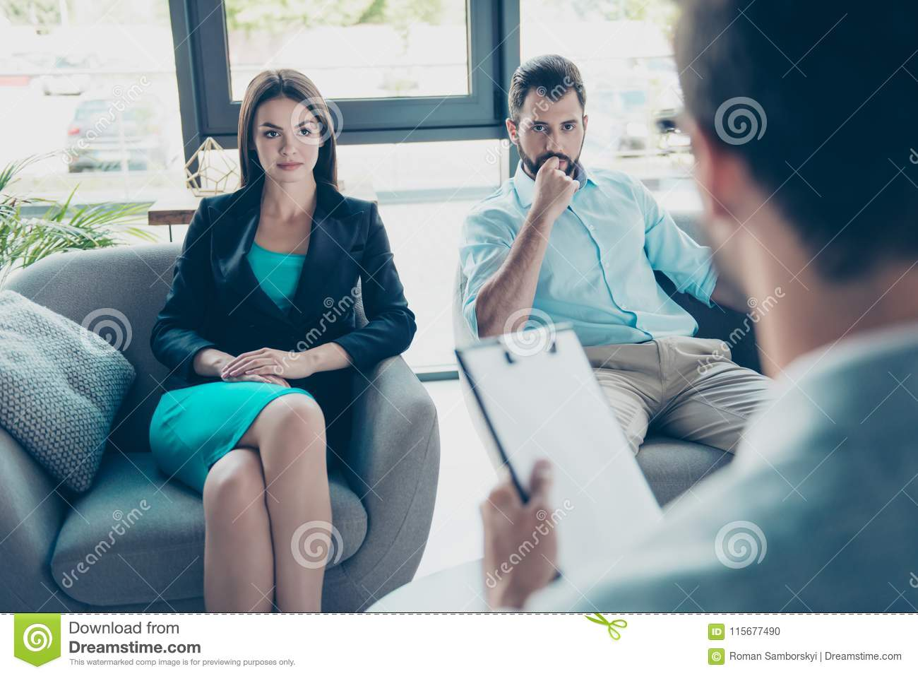 Serious couple is listening to their family doctor, concentrated and  anxious, sex, pregnancy, cheating, mistrust domestic problems concept