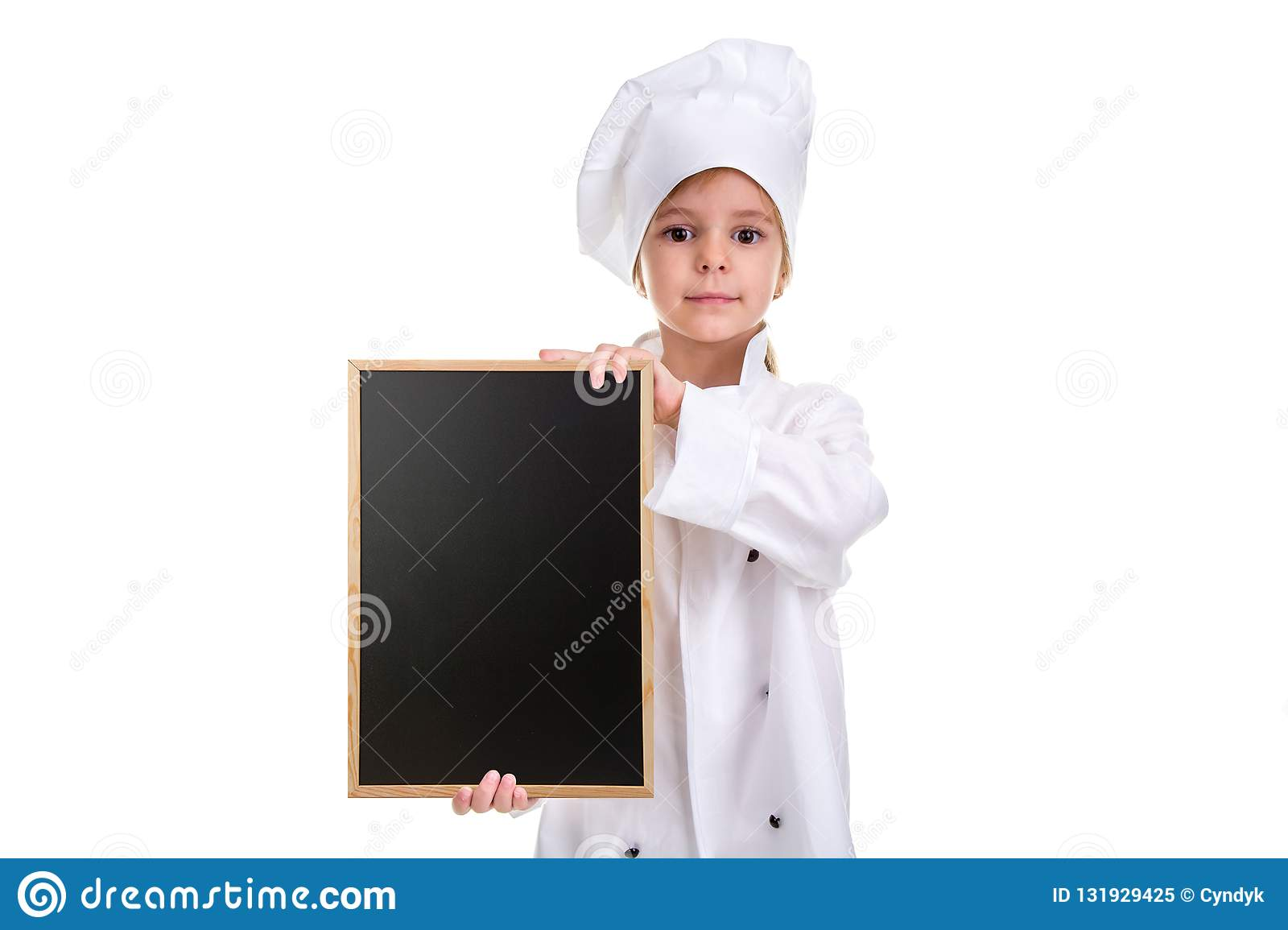 Serious cute girl chef white uniform isolated on white background. Girl with a floured face holding a menu black empty