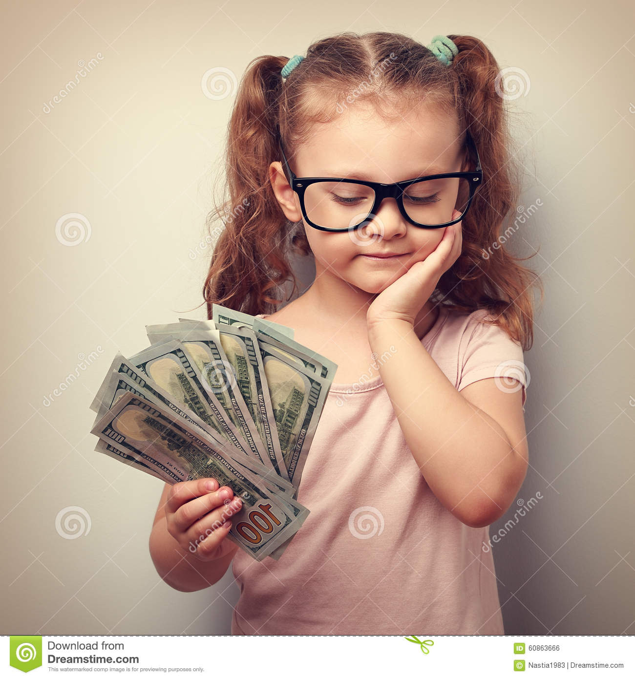 048632da02b Happy Kid Girl In Glasses Holding Money In The Hand And ..