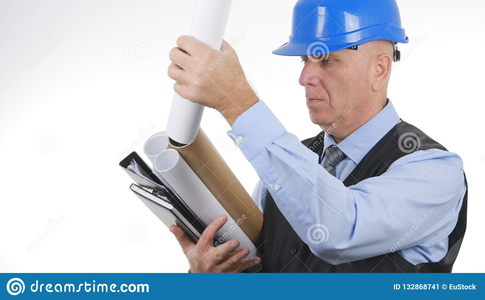 Serious Engineer Working with Plans on White Background