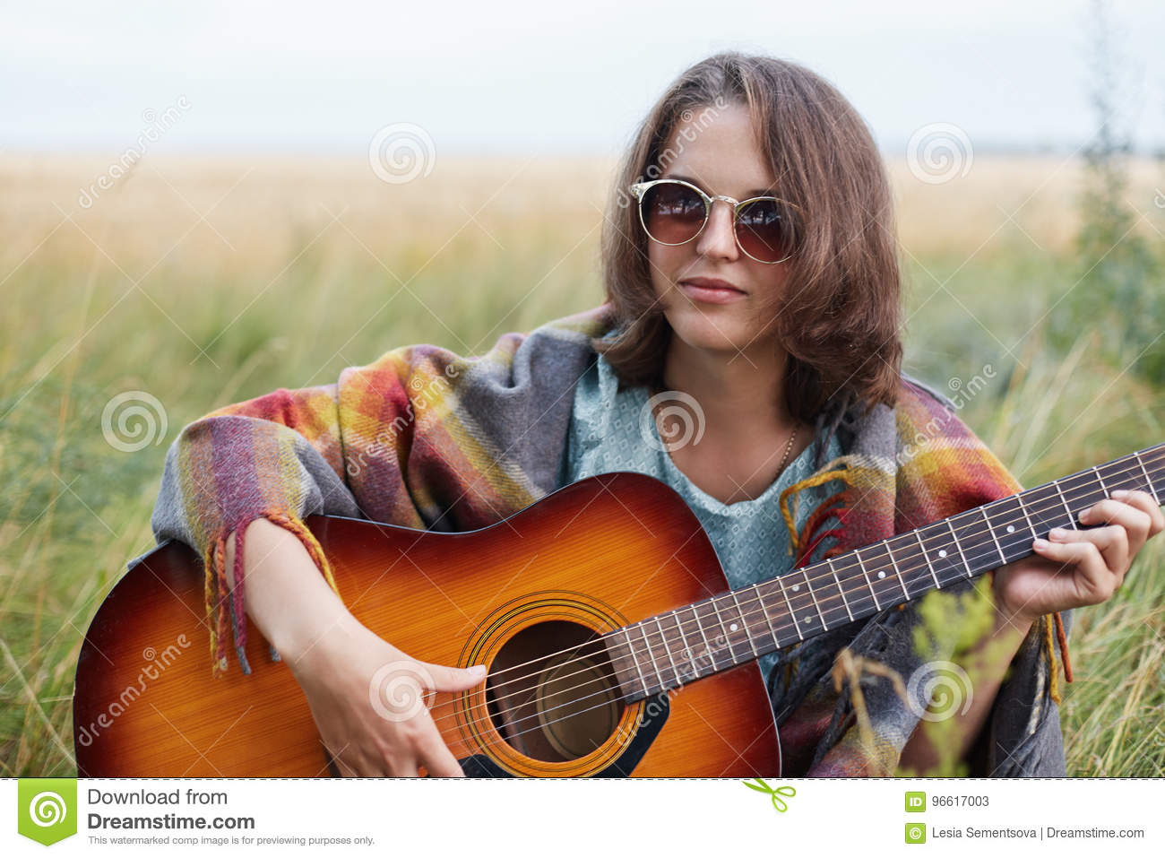 Serious Female With Attractive Appearance Wearing Sunglasses