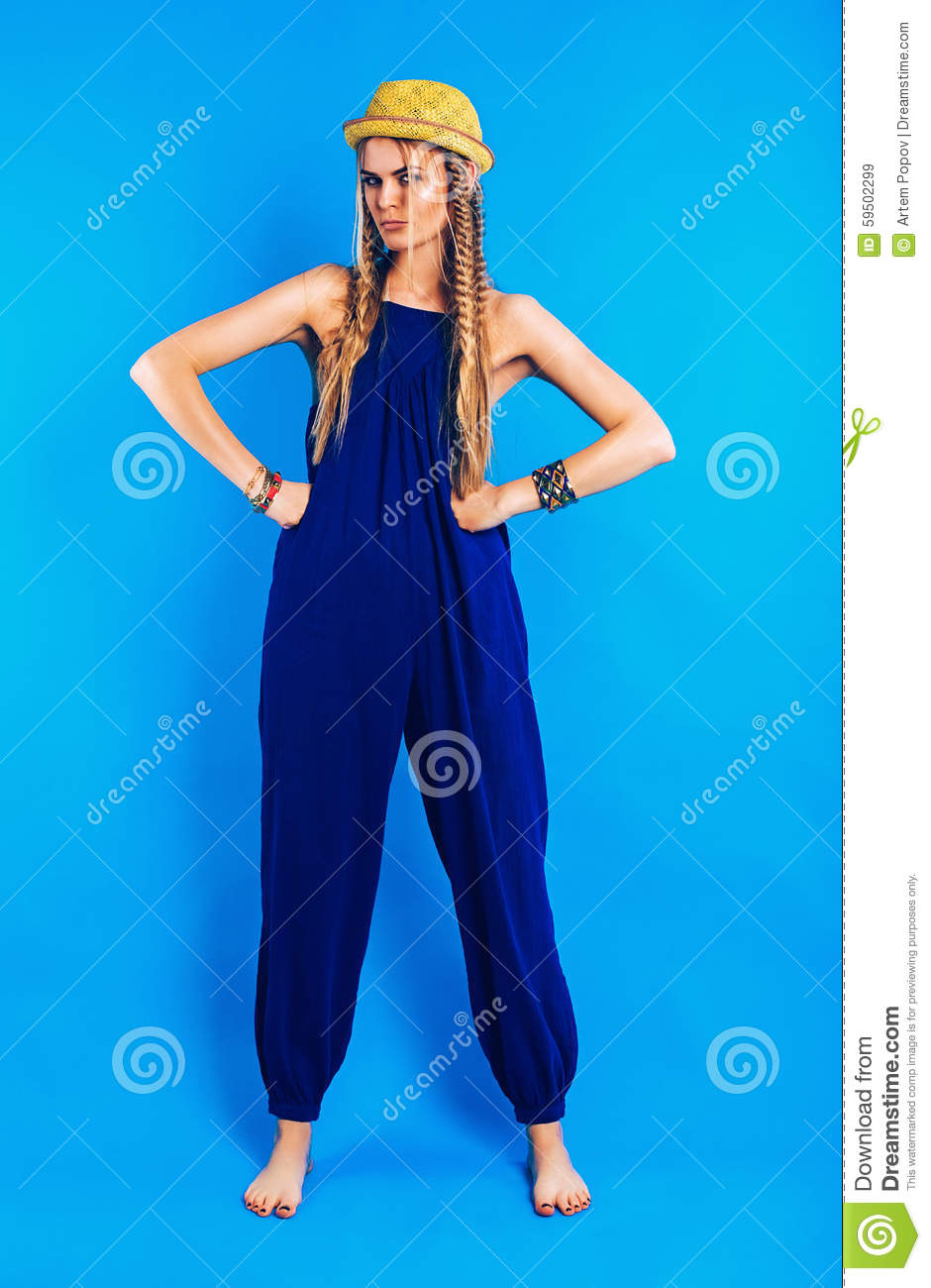 9385811eb977 Serious Funny Woman In Blue Jumpsuit And Straw Hat Stock Image ...