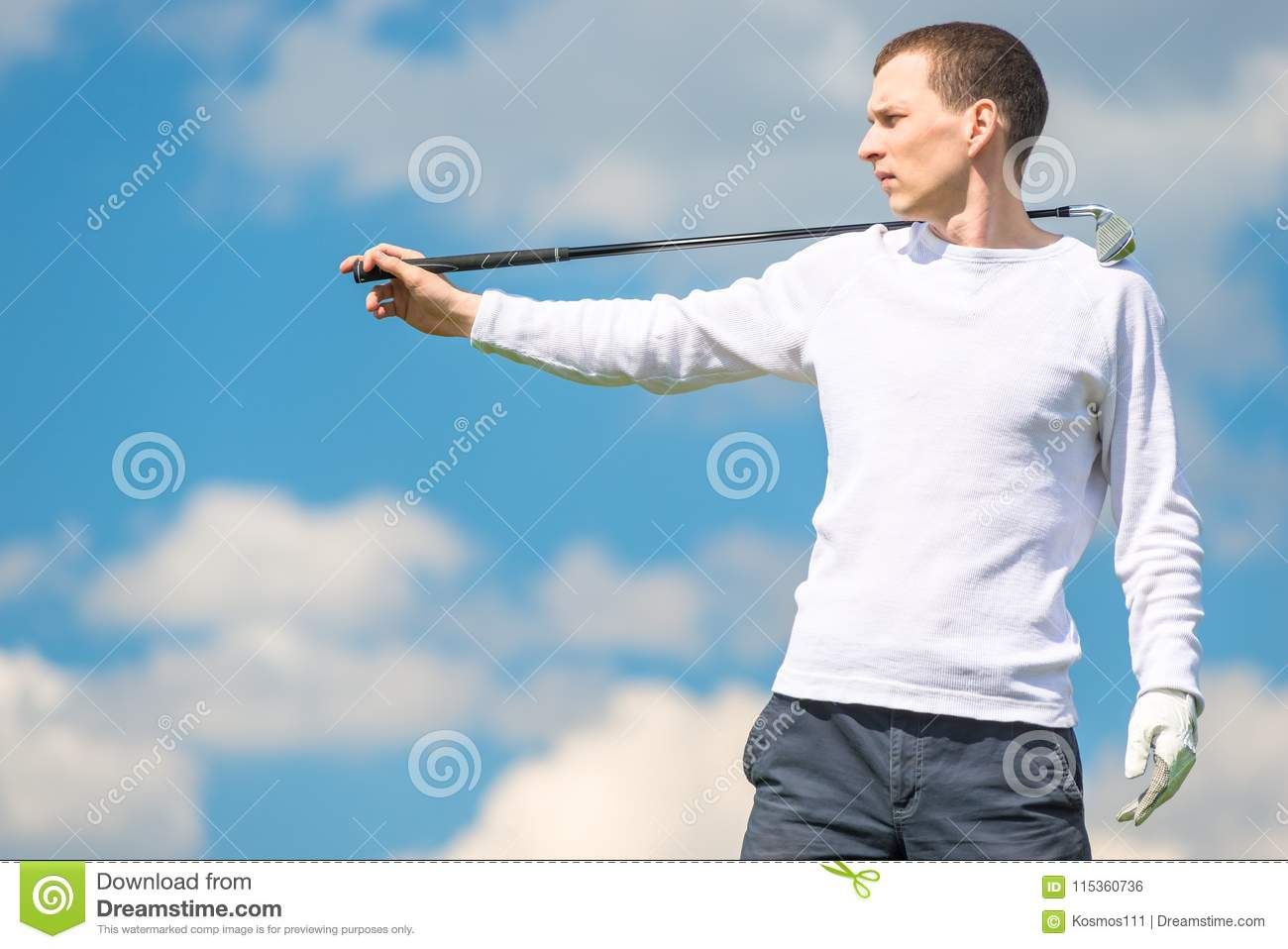 Serious Golfer Professional Posing With Golf Club On Blue Sky Ba