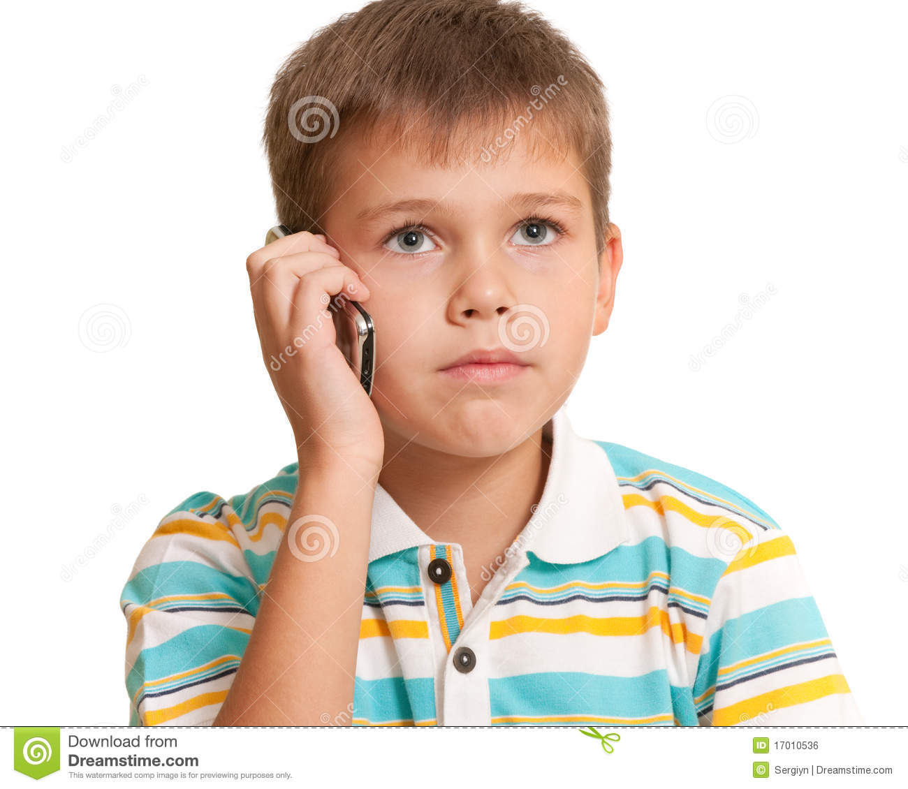 Serious Kid Talking On The Phone Stock Photo - Image: 17010536