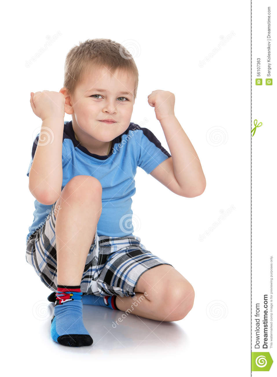serious little boy in shorts and blue tshirt stock image