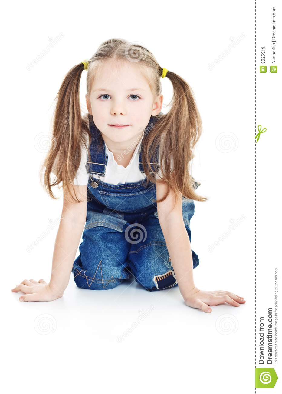 serious little girl in blue jeans royalty free stock