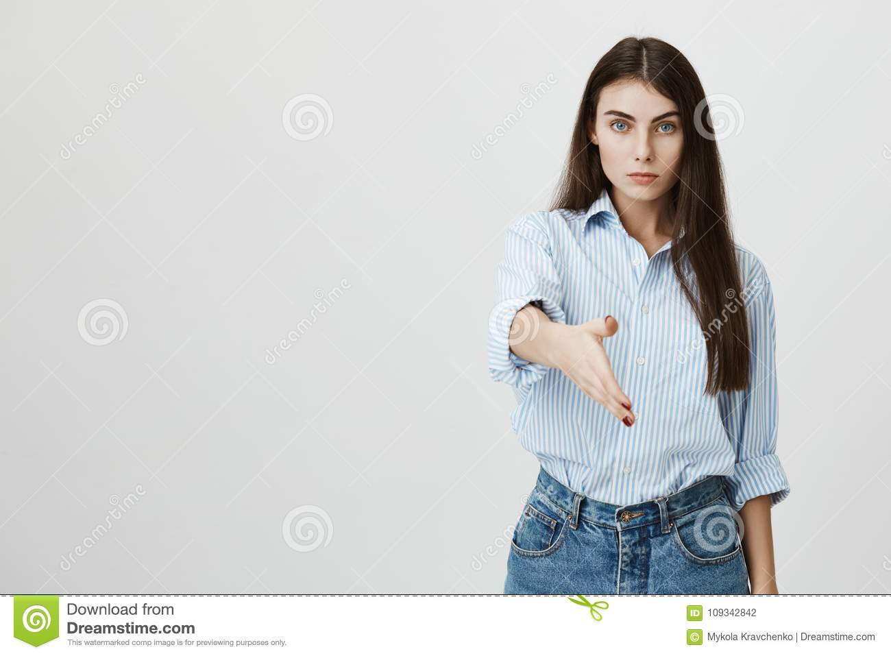 Serious Looking European Woman Stretching Hand To Greet Somebody