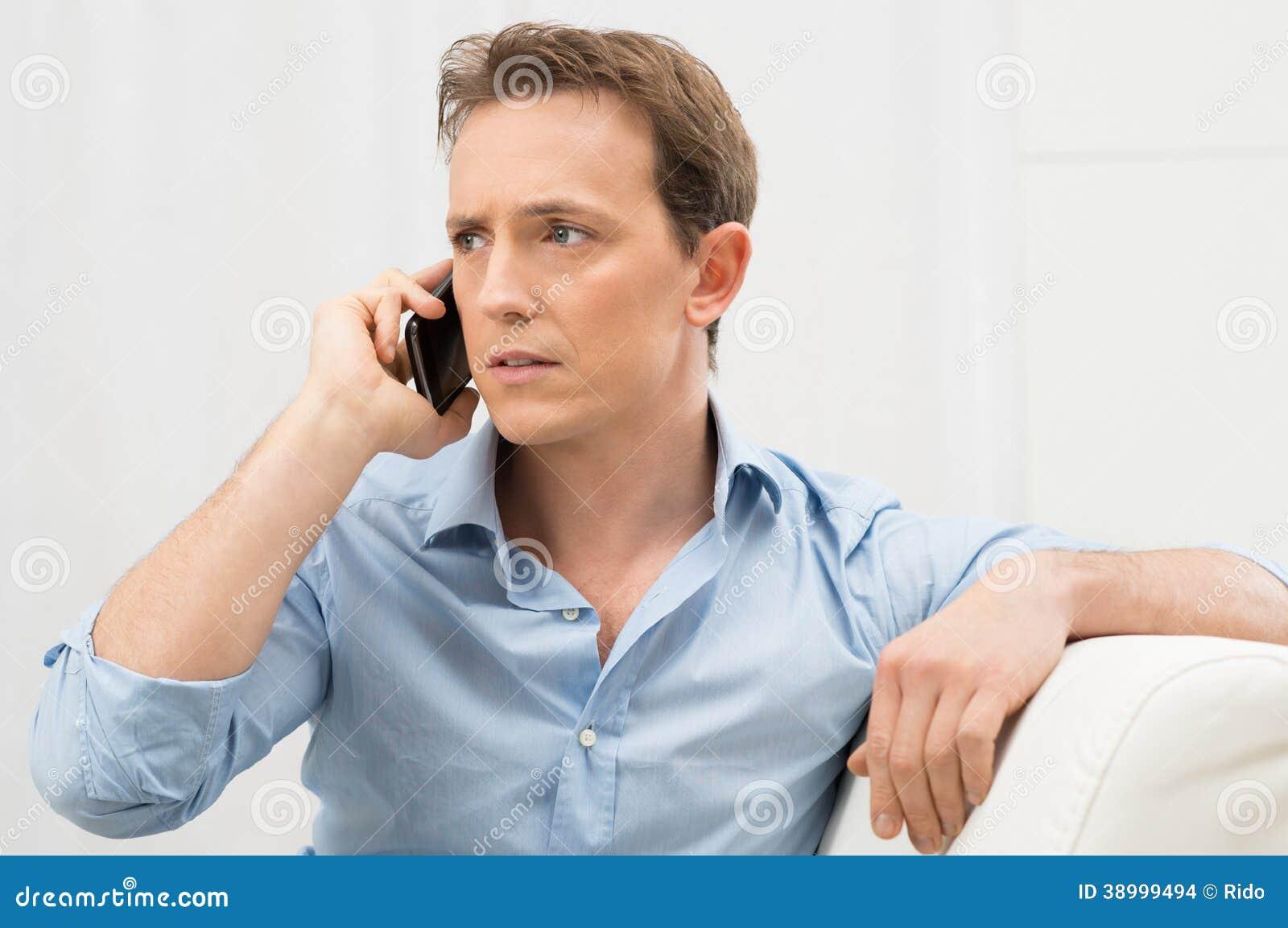 Serious Man Talking On Phone Stock Photo Image 38999494