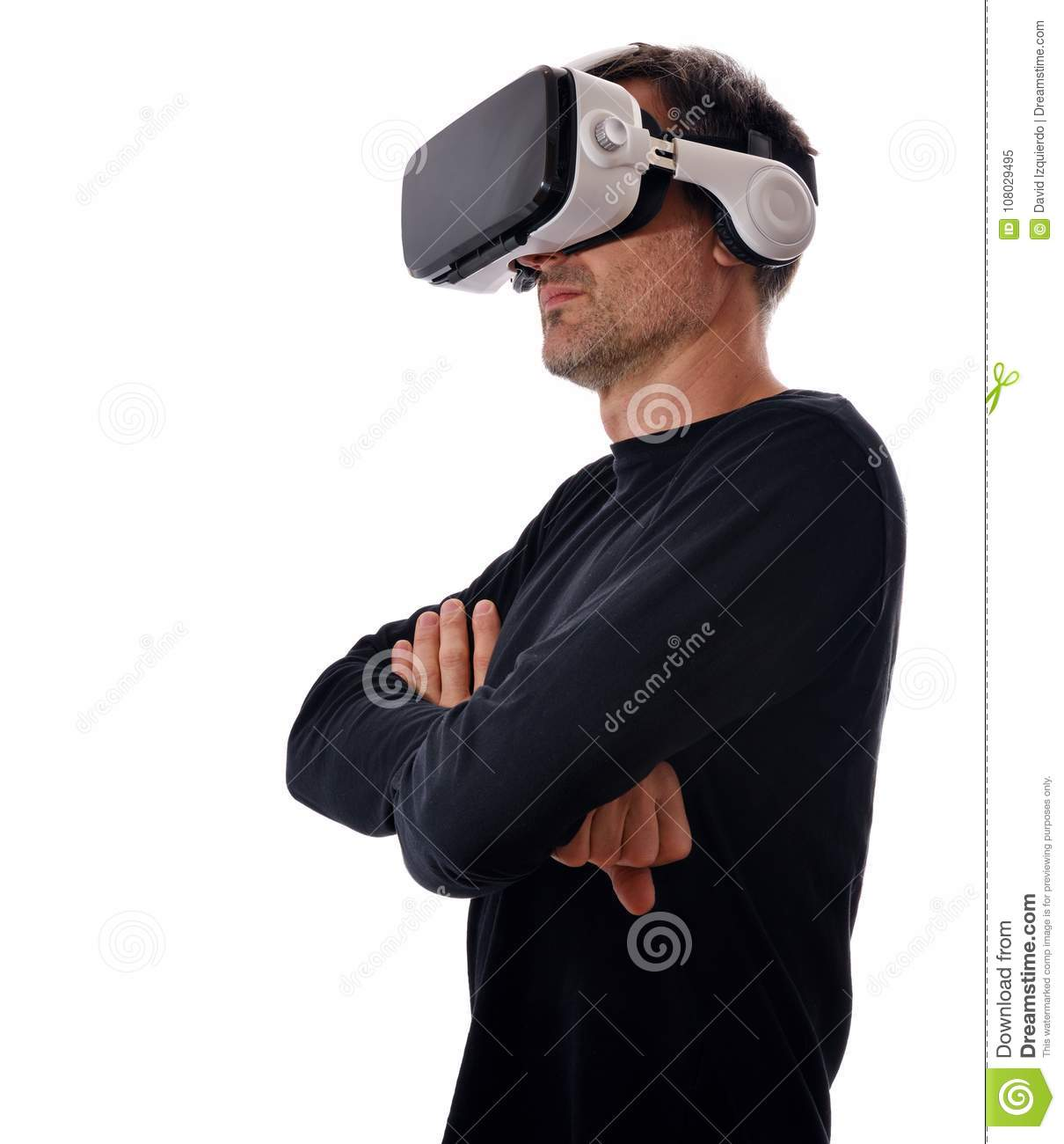 Serious man with virtual reality glasses and arms crossed isolated